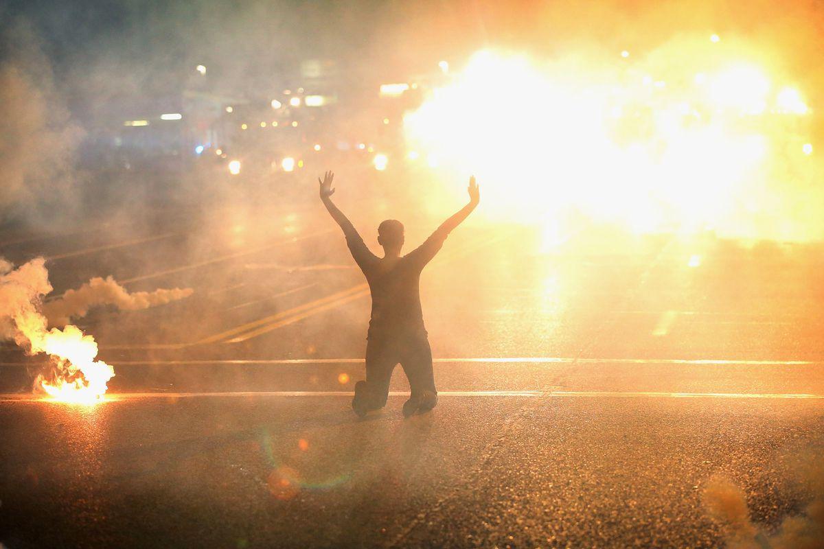 Ferguson protester tear gas