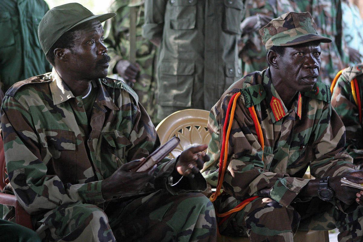 FILE - In this Nov. 12, 2006 file photo Joseph Kony, the Lord's Resistance Army (LRA) leader, left, and his deputy Vincent Otti,  sit inside a tent at Ri-Kwamba in Southern Sudan. A video by the advocacy group Invisible Children about the atrocities carri