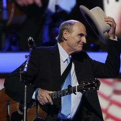 Singer James Taylor tips his hat after  performing a song at the Democratic National Convention in Charlotte, N.C., on Thursday, Sept. 6, 2012.