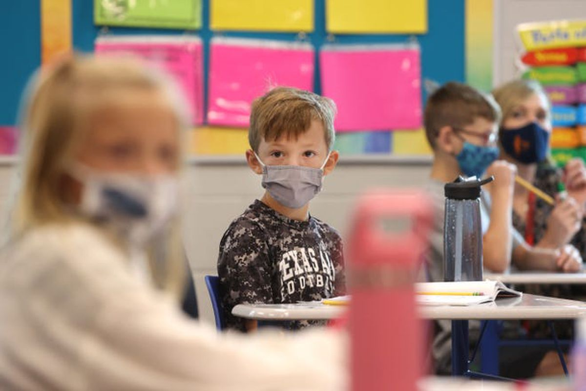 Students in masks sit at their desks in a row at Forest Hill Elementary in Germantown