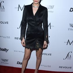 Bella Hadid wore a tuxedo dress from Moschino's fall 2015 collection.