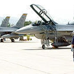 Staff Sgt. Richard Righter walks near a row of F-16s at Hill Air Force Base, which is the largest employer in Utah with nearly 24,000 workers.