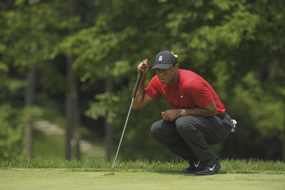 Tiger Woods studies his putt on the eighth hole during the final round of the Memorial Tournament presented by Nationwide at Muirfield Village Golf Club on June 2, 2019 in Dublin, Ohio.