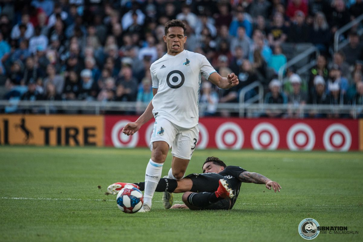 Hasani Dotson gets tangled up during Minnesota United's 4-1 win over Sporting Kansas City in the US Open Cup