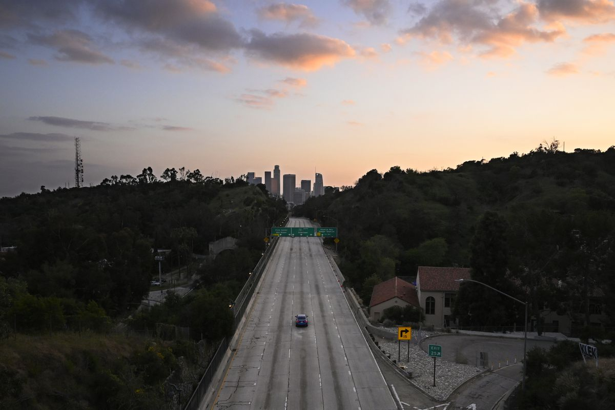 A photo of a highway near downtown Los Angeles with almost no traffic during rush hour on April 2, 2020.