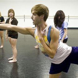 Choreographer Caine Keenan demonstrates a dance move.
