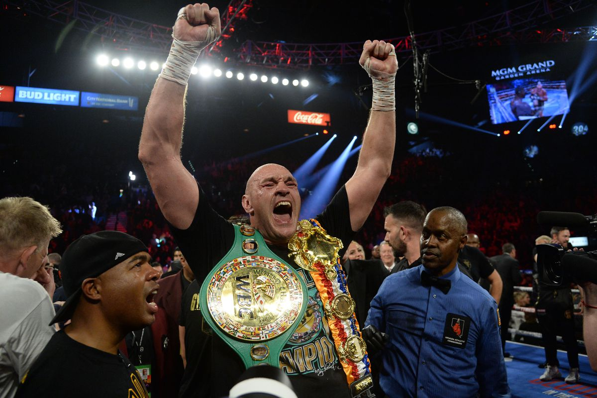 Tyson Fury celebrates after defeating Deontay Wilder in their WBC heavyweight title bout at MGM Grand Garden Arena. Fury won via seventh round TKO