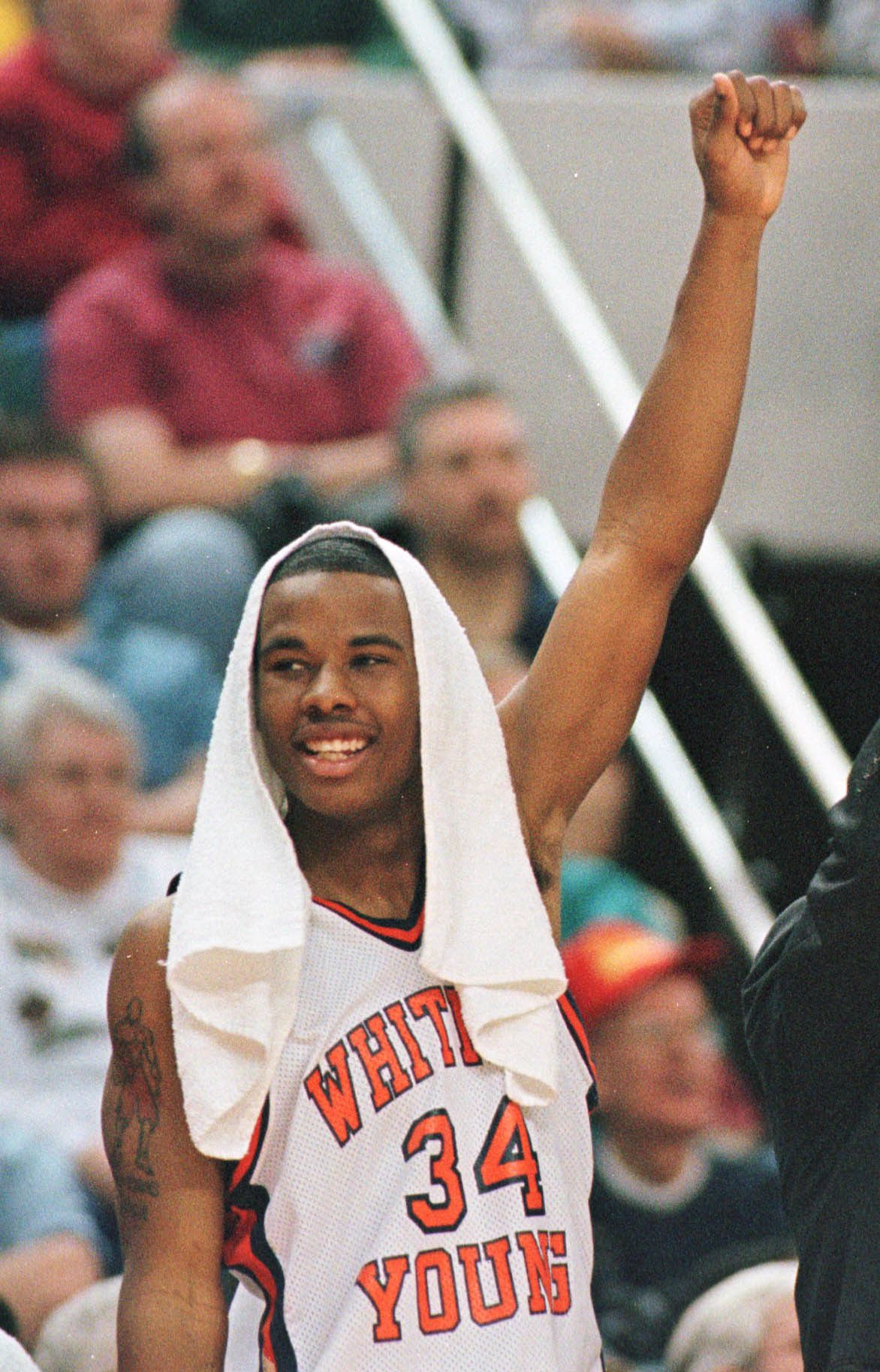 Young's #34 Quentin Richardson celebrates as his team blows out Quincy during a 1998 semifinal game in Peoria.