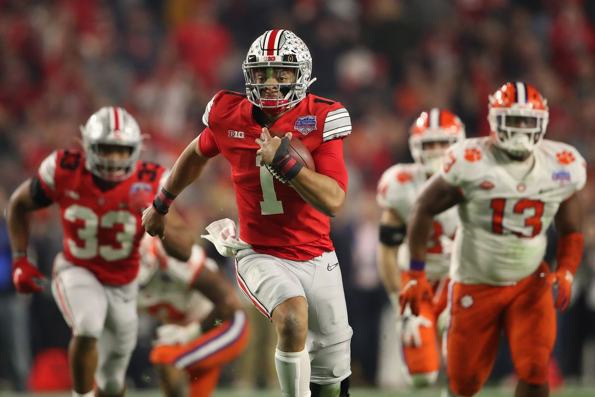 Quarterback Justin Fields of the Ohio State Buckeyes scrambles with the football during the PlayStation Fiesta Bowl against the Clemson Tigers at State Farm Stadium on December 28, 2019 in Glendale, Arizona.