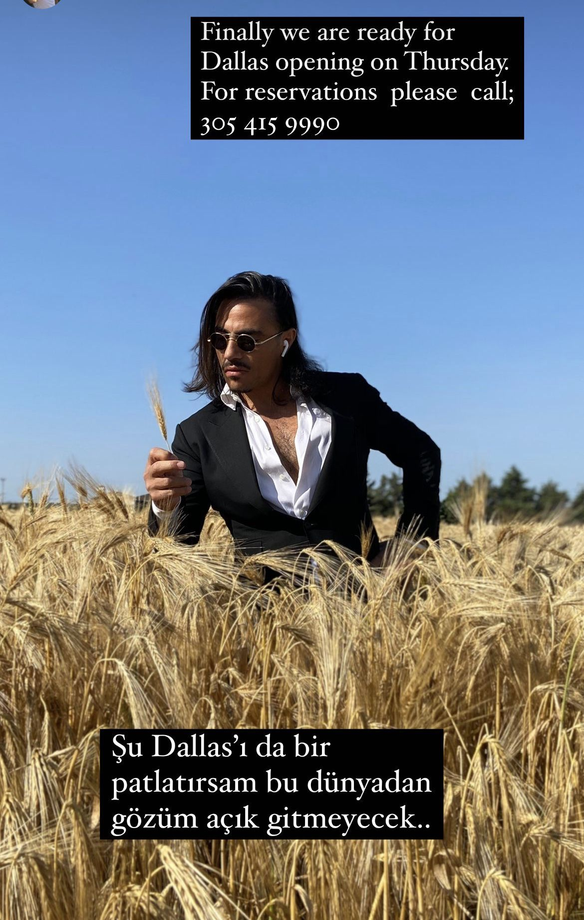 """Nusret """"Salt Bae"""" Gokce standing in a wheat field. The English texts reads """"Finally, we are ready for Dallas opening on Thursday. For reservation, please call 305.415.9990."""