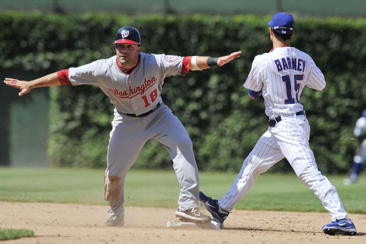No, Danny, you're out: Danny Espinosa of the Washington Nationals is tagged out at second base by Darwin Barney of the Chicago Cubs at Wrigley Field in Chicago, Illinois. The Cubs defeated the Nationals 4-3. (Photo by David Banks/Getty Images)
