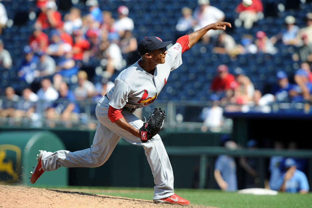 Jun 24, 2012; Kansas City, MO, USA; St. Louis Cardinals relief pitcher Sam Freeman (61) delivers a pitch in the ninth inning against the Kansas City Royals at Kauffman Stadium. St. Louis won the game 11-8. Mandatory Credit: John Rieger-US PRESSWIRE