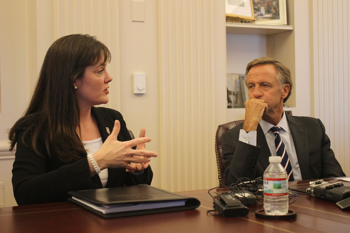 Gov. Bill Haslam and his education chief, Candice McQueen, speak with reporters in May about how Tennessee will handle standardized test results this year because of technical problems administering the exams by computer.