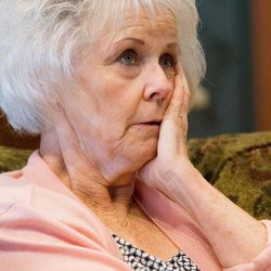 Linda Garfield, of Mona, gathers her thoughts as she and her husband, Rex, talk about how they were defrauded of their retirement savings by investment adviser Tom Andrews on Tuesday, Sept. 13, 2016.