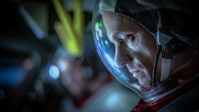 an astronaut played by Joel Kinnaman looks down with his helmet on as he prepares for launch