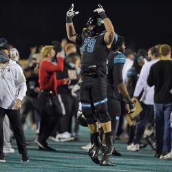 Coastal Carolina's Steven Bedosky (79) celebrates after the team's NCAA college football game against BYU on Saturday, Dec. 5, 2020, in Conway, S.C. Coastal Carolina won 22-17.