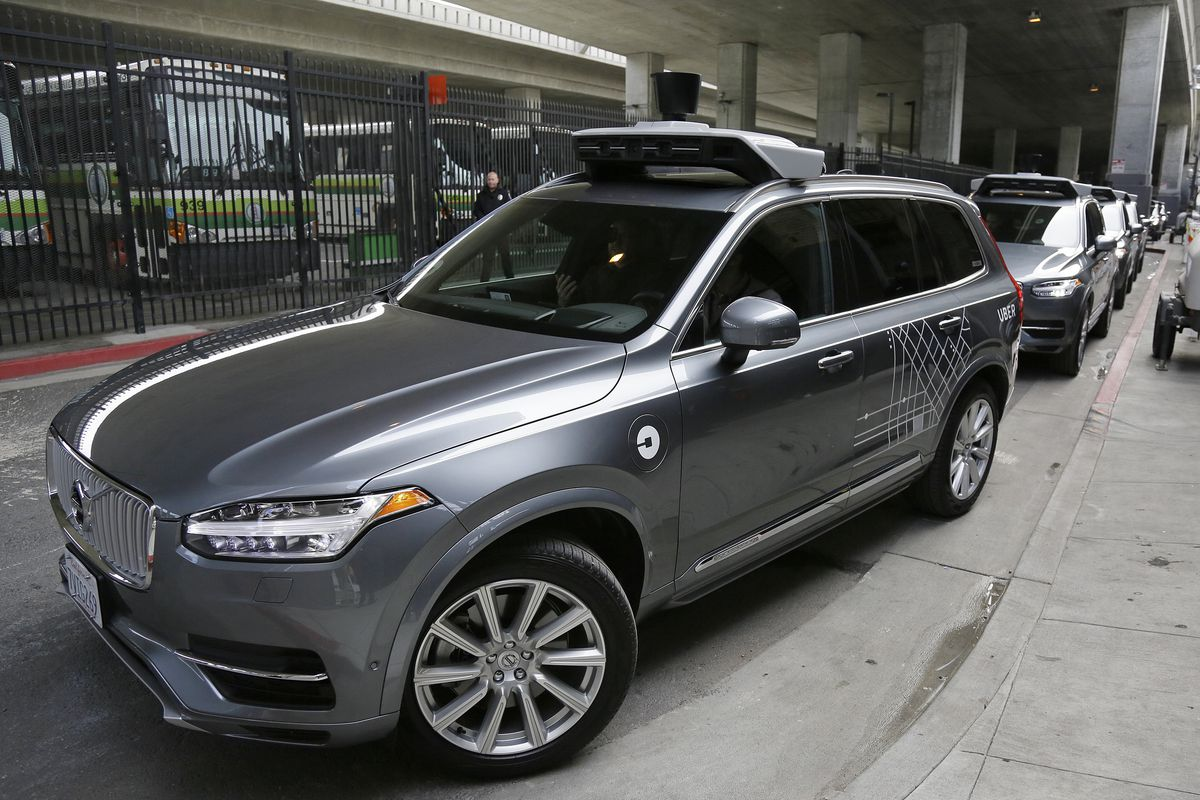 FILE - In this Dec. 13, 2016 file photo, Uber's autonomous car heads out for a test drive in San Francisco. The Utah House put its collective foot on the gas of moving a proposal forward that would clear the lanes for autonomous vehicles on state highways
