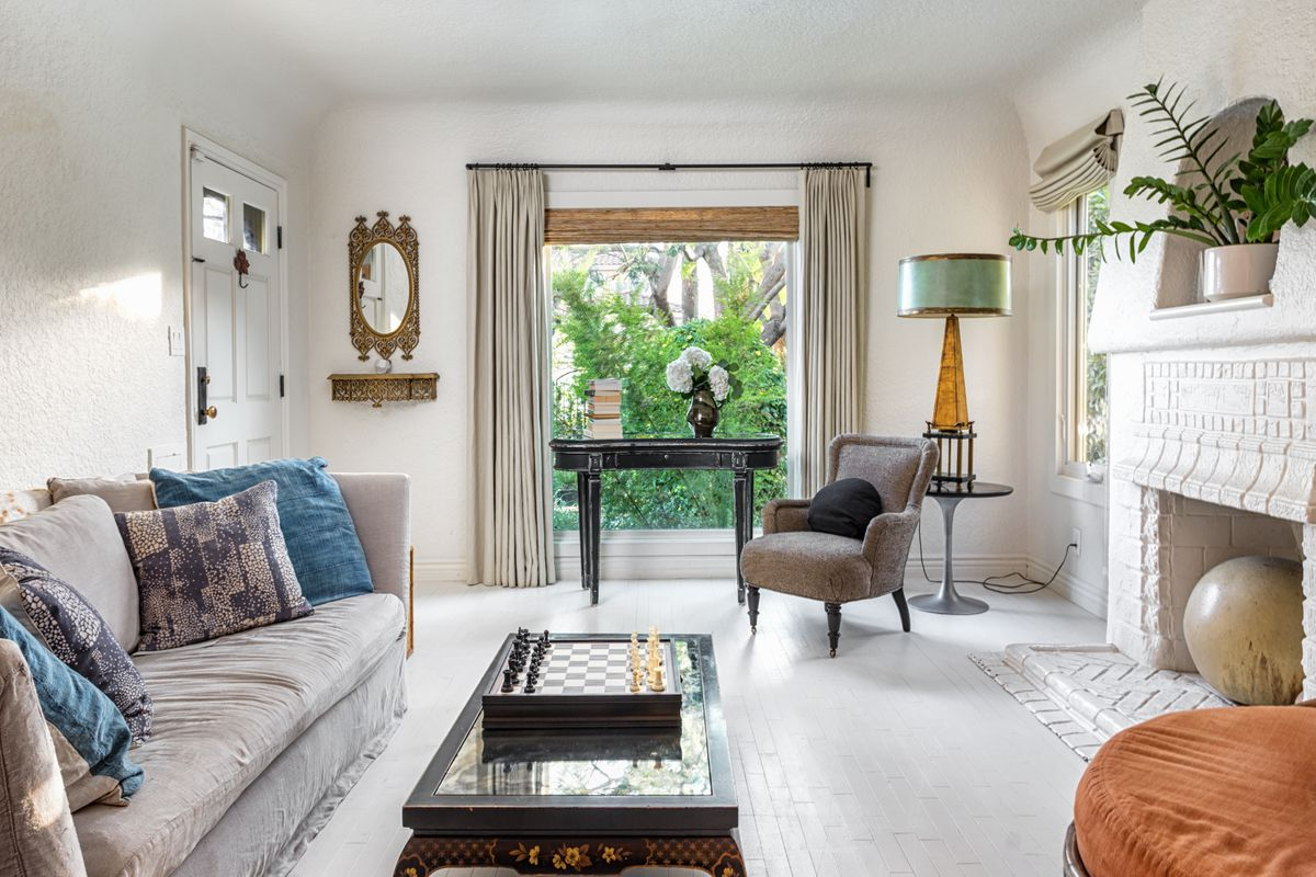 Spanish style house brings fancy bohemian vibes to del rey for Living room 8 place jean rey