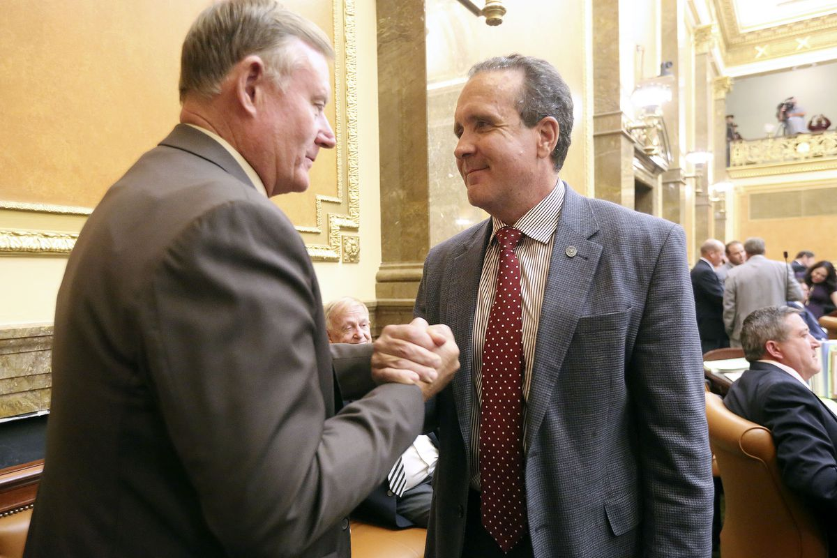 Sen. Evan Vickers, R-Cedar City, and Rep. Brad Daw, R-Orem, shake hands after a bill they co-sponsored, SB1002 Medical Cannabis Amendments, passed both House and Senate votes during a special legislative session at the Capitol in Salt Lake City on Monday, Sept. 16, 2019.