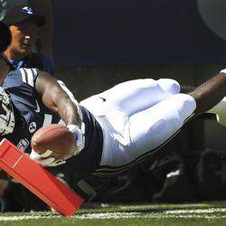 BYU Cougars running back Ty'Son Williams (5) dives for the end zone against the USC Trojans at LaVell Edwards Stadium in Provo on Saturday, Sept. 14, 2019.