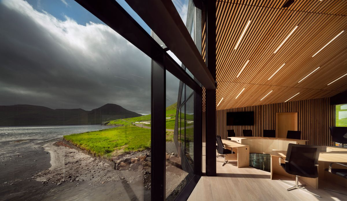 Floor to ceiling windows looking out onto water