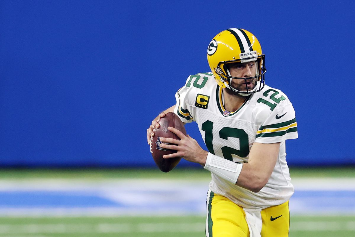 Aaron Rodgers #12 of the Green Bay Packers looks to pass during the first half against the Detroit Lions at Ford Field on December 13, 2020 in Detroit, Michigan.