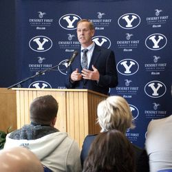 Tom Holmoe, Director of Athletics at Brigham Young University, speaks during a press conference announcing a new contract for Coach Dave Rose Wednesday, April 6, 2011