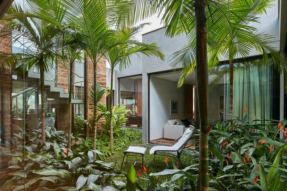 Architect David Guerra Puts A Lush Courtyard In The Middle Of This Rectilinear Home Brazil