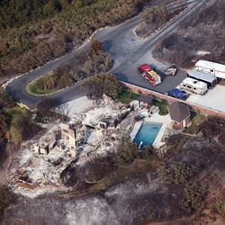 The ruins of a home destroyed in Tuesday's fire in Weber County can be seen Wednesday, Sept. 6, 2017. More than 100 families were waiting to return home to Weber Canyon after a 600-acre fire charred a half-dozen houses and continued to threaten others.