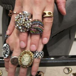Andrew puts on as many rings as he can. They're each priced under $50!