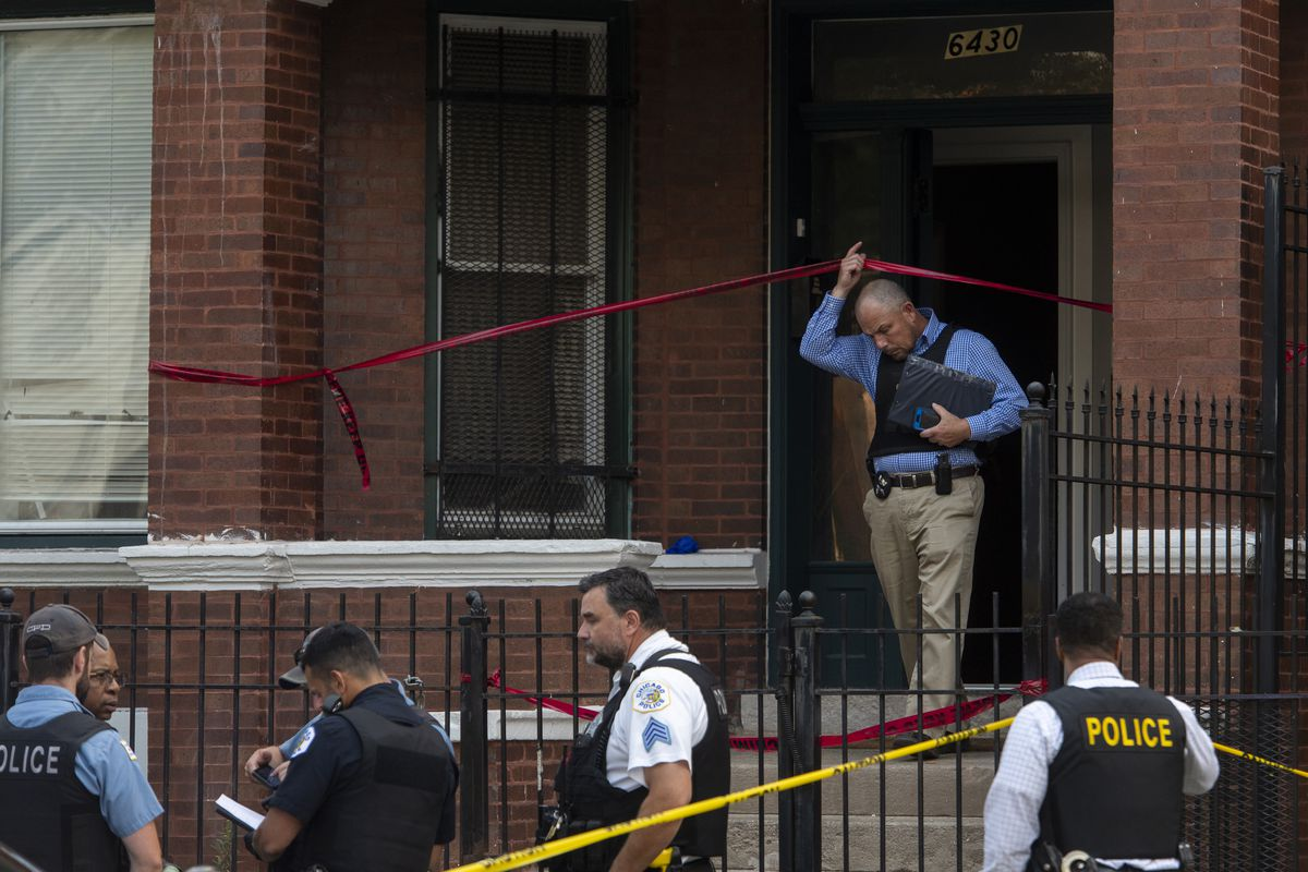 Chicago police work the scene where a 4-year-old was shot and killed in an apparent accidental shooting, in the 6400 block of South Carpenter, in the Englewood neighborhood, Thursday, Aug. 5, 2021.