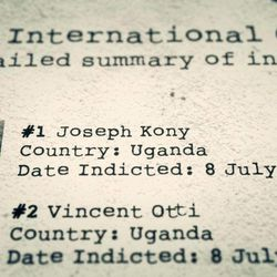 """This image provided by Invisible Children shows an International Criminal Court indictment list displaying Joseph Kony and Vincent Otti from the video, """"Kony 2012 Part II.""""  Part II repeats some of the same slick, inspiring shots as the original of a young global community mobilizing into action. But noticeably missing is the voice of the organization's co-founder, Jason Russell, who directed the first video."""