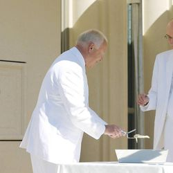 President Henry B. Eyring and Elder Kent Richards prepare to mortar the cornerstone during the Payson Utah Temple cornerstone ceremony  in Payson  Sunday, June 7, 2015.
