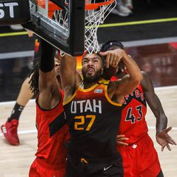 Utah Jazz center Rudy Gobert (27) fights the Toronto Raptors for the ball during an NBA basketball game at Vivint Smart Home Arena in Salt Lake City on Saturday, May 1, 2021.