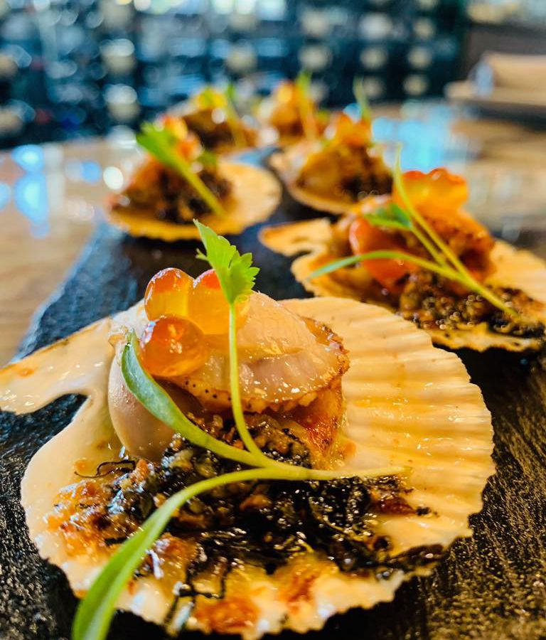 Singing pink scallops with shiso butter at Mordeo Boutique Wine Bar