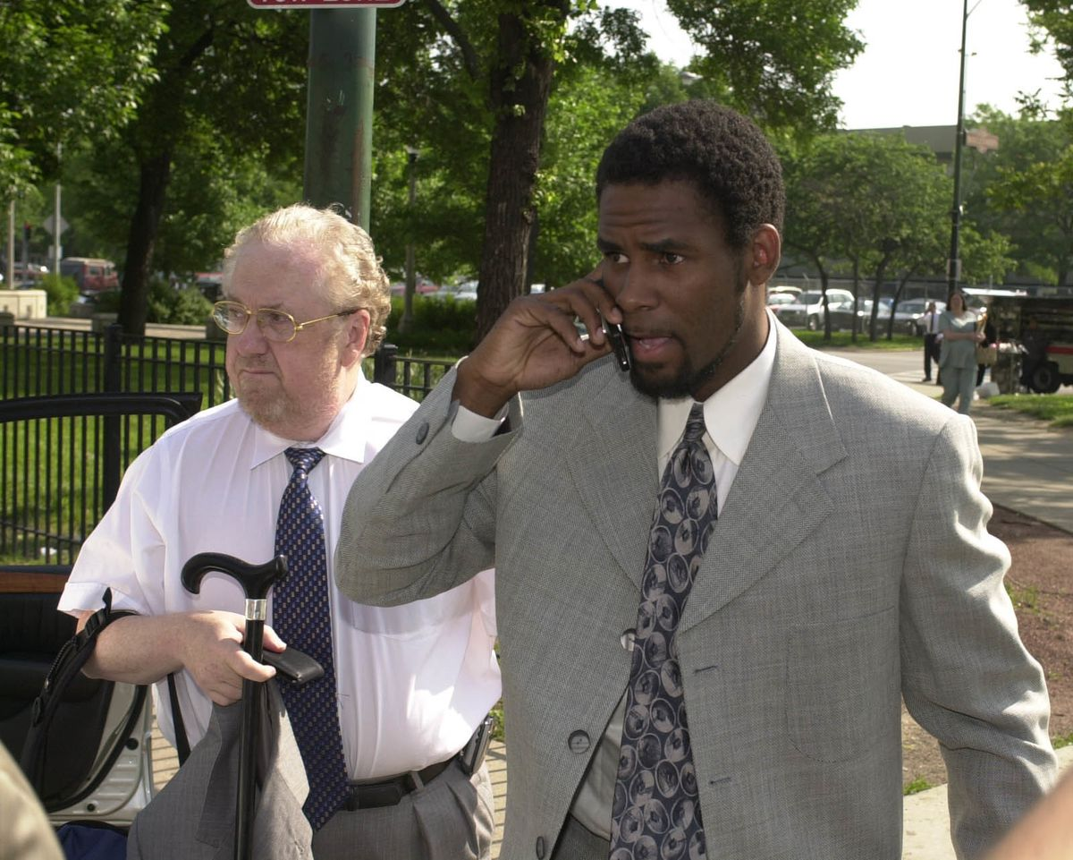 R. Kelly arrives in 2002 at the Leighton Criminal Courts Building in Chicago with Ed Genson to turn himself in and was arrested moments after this picture was taken.