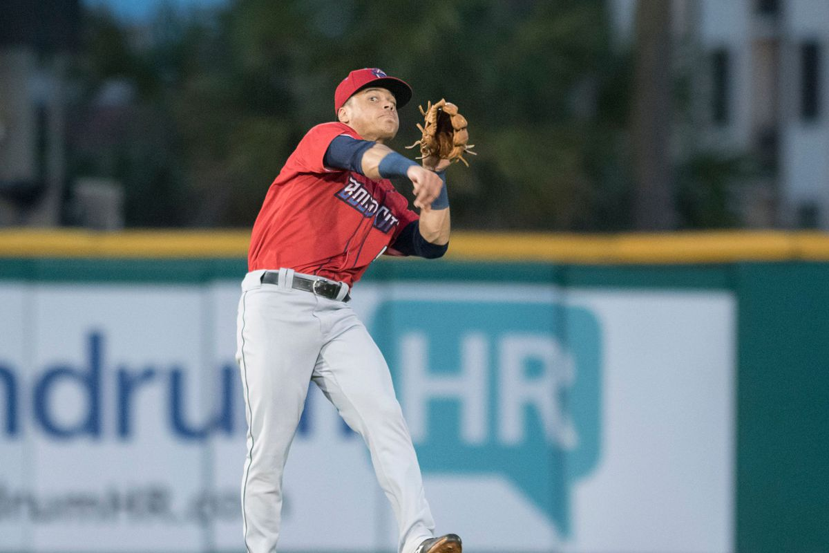 Second baseman Bryson Brigman (6)'s off balance throw is too late to get Tanner English (4) at first base during the Jacksonville Jumbo Shrimp vs Pensacola Blue Wahoos baseball game in Pensacola