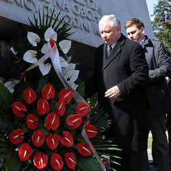 Polish opposition leader Jaroslaw Kaczynski, second right, lays a wreath at the memorial dedicated to the 96 victims of the presidential plane crash, among them his twin brother President Lech Kaczynski, as he commemorates the second anniversary of the accident, at the Powazki cemetery in Warsaw, Poland, Tuesday, April 10, 2012. Exactly two years ago a plane with Polish President Lech Kaczynski, his wife and officials crashed in Russia, killing all on board.