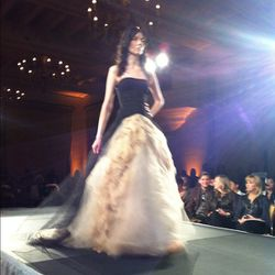 Black stretch chiffon and silk faille strapless ballgown with sheer boned bodice and nude crushed tulle skirt.
