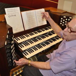 Dan Starks, with the Concert and Lecture Series Committee  of the Logan Tabernacle, explains the history and unique features of the organ.
