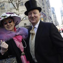 Stephen Jones, right, poses for photographers with a member of the Milners guild during the Easter Parade Fifth Ave.,  Sunday, April 8, 2012 in New York.