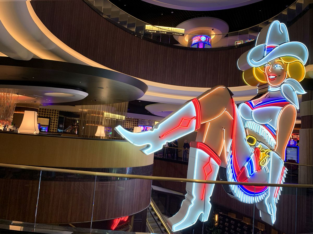 A view of a cocktail lounge and a neon cowgirl