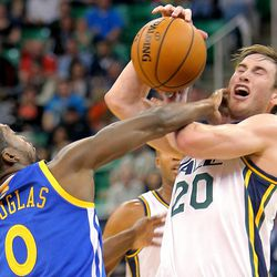 Utah's Gordon Hayward is fouled by Warriors' Toney Douglas as the Utah Jazz and the Golden State Warriors play Tuesday, Oct. 8, 2013 in preseason action at Energy Solutions arena in Salt Lake City.
