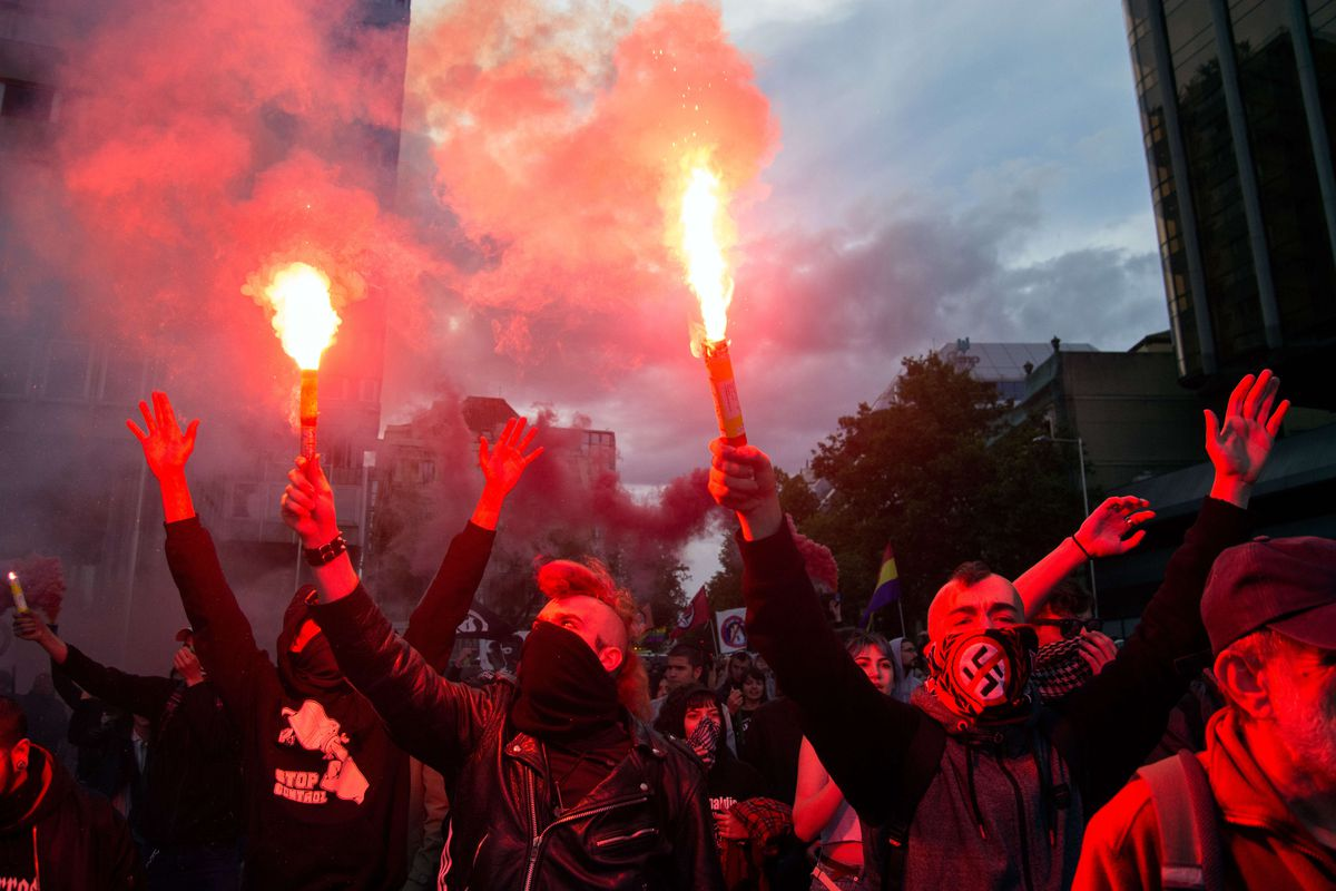 Left-wing antifa protesters rally against a far-right group in Madrid, Spain.