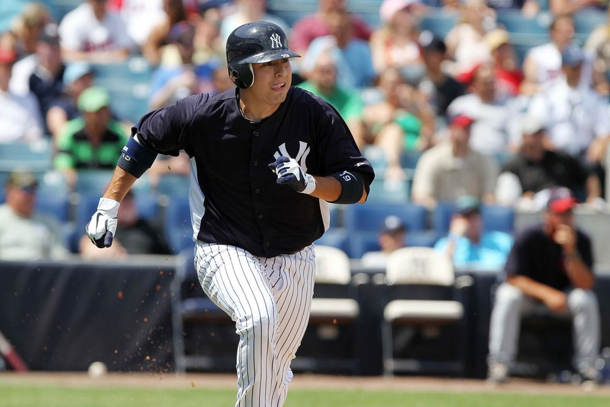 March 23, 2012; Tampa, FL, USA; New York Yankees third baseman Ramiro Pena (19) hits a solo home run in the seventh inning against the New York Yankees at George M. Steinbrenner Field. Mandatory Credit: Kim Klement-US PRESSWIRE