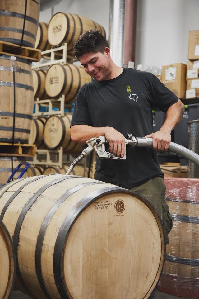 Filling a barrel at Still Austin