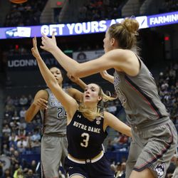 UConn's Katie Lou Samuelson (33) waits for the pass from Napheesa Collier (24) over Notre Dame's Marina Mabrey's (3) arm during the Notre Dame Fighting Irish vs UConn Huskies women's college basketball game in the Women's Jimmy V Classic at the XL Center in Hartford, CT on December 3, 2017.