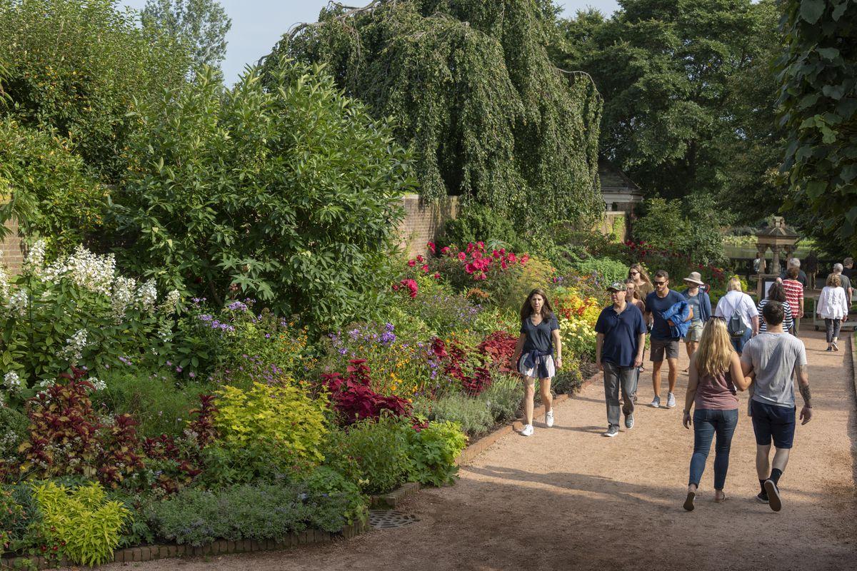 Visitors walk through the gardens.