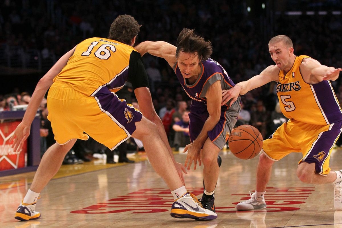 Steve Nash #13 of the Phoenix Suns chases a loose ball against Pau Gasol #16 and Steve Blake #5 of the Los Angeles Lakers at Staples Center on January 10, 2012 in Los Angeles, California.  The Lakers won 99-83. (Photo by Stephen Dunn/Getty Images)