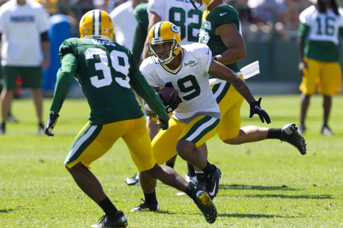 Green Bay Packers wide receiver Diondre Borel (19) rushes with the football as cornerback Brandian Ross (39) defends during training camp practice